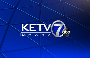 """KETV Omaha"" written in white block lettering both positioned next to a silver 7 and ""abc"" written inside of a black circle. All of this positioned on a blue background"