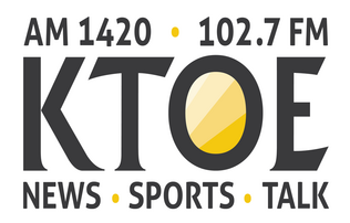 """AM 1420 102.7 FM"" written above ""KTOE"" written above ""News"", ""Sports"", and ""Talk"" all written in Black font on a white background."