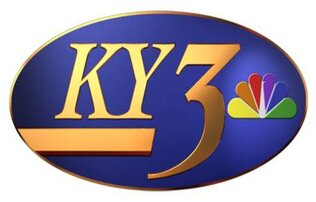 "Purple circle surround gold lettering that writes ""KY3"" along with a rainbow colored fan icon"