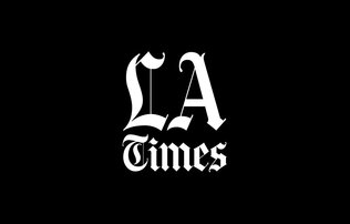 """LA Times"" written in white gothic font on a black background"