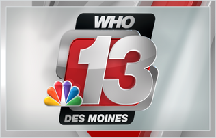 """WHO 13 De Moines"" written in silver lettering on a red and silver background positioned next to a rainbow fan"