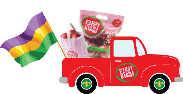 """Red pick-up truck with """"First Kiss"""" written on the door. Two bags of apples and a mardi gras flag sit in the trunk."""
